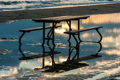 Picnic Table with Reflections in Water Stock Photography