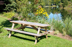 Picnic table at a river Stock Photos