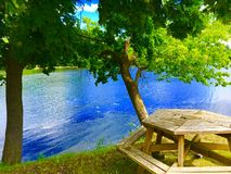 Picnic Table By A River. A picnic table by a river Royalty Free Stock Image