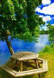 Picnic Table By A River. A picnic table by a river Stock Photography