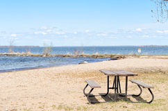 Picnic table on sandy beach. Picnic table on beach at Sibbalds Provincial Park, Ontario Royalty Free Stock Image