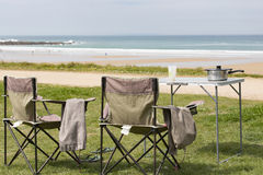 Picnic table sea view. Picnic table lunch on grass sea view nobody France Normandy Stock Image