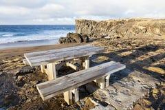 Picnic table at Snaefellsnes peninsula. Picnic table near a beach at Snaefellsnes peninsula, Iceland Royalty Free Stock Image