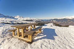 Picnic table on a snowy mountain top Royalty Free Stock Photos