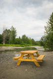 Picnic Table Beside Stream Stock Photography