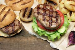Picnic Table Top With BBQ Grilled Burgers And Vegetables Royalty Free Stock Photography