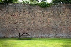 Picnic Table and wall Stock Images