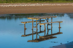 Picnic Table in Water at Beach Royalty Free Stock Images
