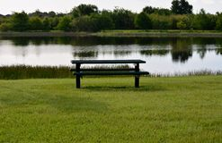Picnic Table & Water Royalty Free Stock Photos