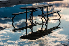 Picnic Table in Water with Reflected Sky Stock Photos