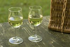 Picnic table with wineglass Royalty Free Stock Photography