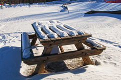 Picnic table after winter snowfall Stock Images