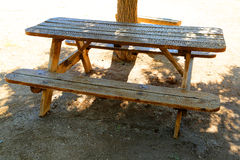 Picnic table. Wooden picnic table in the desert Stock Images