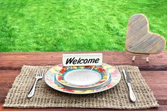 Picnic Table with Wooden Heart and Sign Welcome Stock Image
