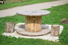 Picnic table and wooden logs to serve as a chair stock image