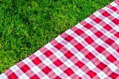 Picnic tablecloth on the grass Stock Photo