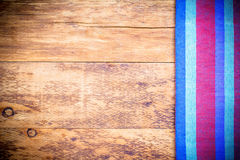 Picnic tablecloth on old wooden table top view Royalty Free Stock Images