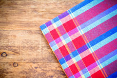 Picnic tablecloth on old wooden table top view.  Stock Image
