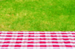 Picnic tablecloth on the table. Picnic tablecloth textile on the table background Stock Photos