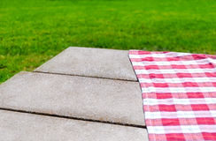 Picnic tablecloth on the table. Picnic tablecloth textile on the table background Royalty Free Stock Photos