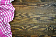 Picnic tablecloth on wooden table. Pink picnic tablecloth on wooden table Royalty Free Stock Image