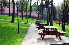 Picnic tables. Wooden picnic tables in a park Royalty Free Stock Images