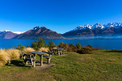 Picnic tables against winter mountain landscape on the backgroun Stock Images