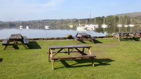 Picnic tables at Ambleside, Lake Windermere. Stock Photos