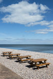 Picnic Tables on the Beach. At Budleigh Salterton, Devon, UK Stock Image