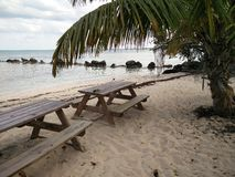 Picnic tables on a beach Stock Photo