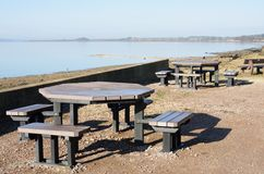 Picnic Tables by the Coast Stock Photos