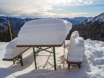 Picnic tables covered with snow flakes after the snowfall Stock Images