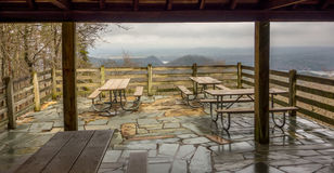 Picnic tables with mountain view background Stock Photos