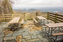 Picnic tables with mountain view background Royalty Free Stock Images