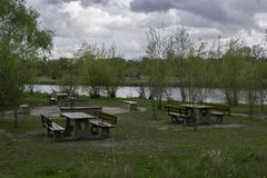 Picnic tables near a river. Picnic tables near the Warta river Stock Photography