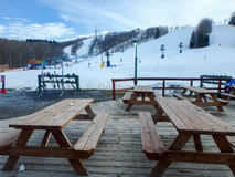 Picnic tables near a ski resort mountainpicnic tables near a ski Royalty Free Stock Image