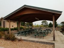 Picnic tables and pavilion and bathrooms or restrooms. Picnic tables and covered pavilion and bathrooms or restrooms royalty free stock photos