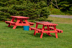Two red picnic tables Royalty Free Stock Photography