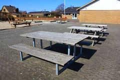Picnic tables. Beside playground Royalty Free Stock Photography