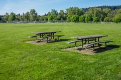 Picnic tables in public park Royalty Free Stock Image