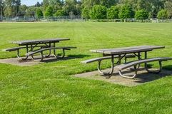 Picnic tables in public park Stock Image
