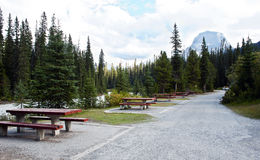 Picnic tables  by the river Stock Photo