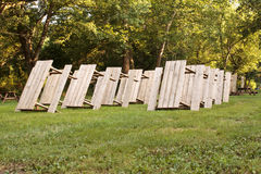 Picnic Tables Rows. Rows of picnic tables standing up in a camping park setting Stock Images
