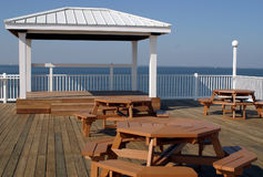 Picnic Tables and Stage. Picnic tables at an outdoor cafe.  There is a stage and a beautiful view Stock Photography