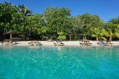 Picnic tables on tropical beach French Polynesia Stock Photos