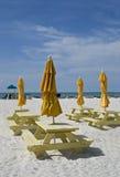 Picnic tables and umbrellas Stock Photos