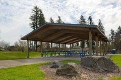 Picnic Tables under Shelter in City Park Stock Images