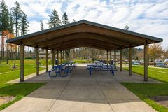 Picnic Tables under Shelter in Suburban City Park Royalty Free Stock Photos