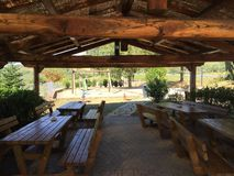 Picnic tables under thatched roof Royalty Free Stock Images