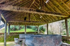 Picnic tables under wooden roof shelter structure in Sao Miguel. stock image